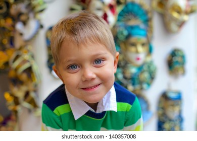 Clouse-up portrait of little boy. Carnival in Venice, Italy.