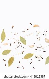 Clove, paprika, garlic and bay leaf on white background