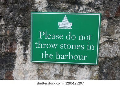 Clovelly. Devon. England. June 9. 2018. Please do not throw stones in the harbour.