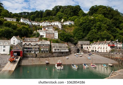 Clovelly, Devon, UK. jULY 2011. A view of Clovelly harbour and lifeboat station. With fishing boats moored and cottages on the hillside.