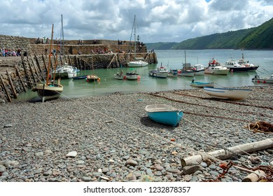 Clovelly, Devon, UK - July 8, 2008: Clovelly harbour with moored boats on a cloudy summer day