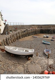 Clovelly Harbour and rowing boat, Devon