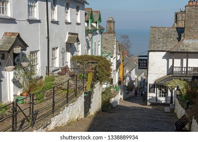Clovelly, North Devon, England, UK. March 2019. Clovelly a tiny coastal town with a main street which is cobbled and goes very steeply to the seafront.