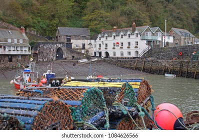 Clovelly which is a small village in the Torridge district of Devon with a small harbour and a lots of fishing equipment in the front