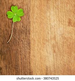 a clover on wooden desk