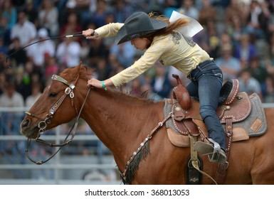CLOVERDALE, CANADA - MAY 21, 2012: A cowgirl competes in Ladies Barrel Race category at the annual Cloverdale Rodeo on May 21, 2012 in Cloverdale, BC, Canada.