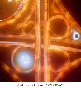 Cloverleaf interchange highway junction, aerial top down view