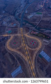 Cloverleaf motorway junction at night from the sky