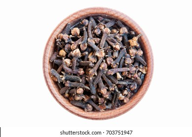 Cloves. Cloves is isolated on a white background. Clove in a wooden bowl