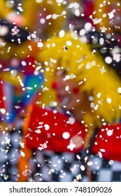 a clown behind a shower of confetti coming down