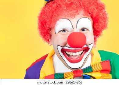 clown close on yellow background
