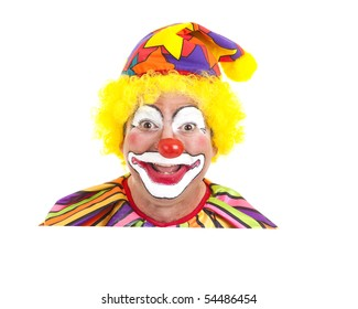 Clown face peeking over blank white space.  Isolated design element.