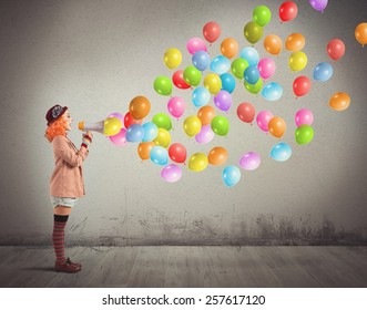 Clown funny and creative screams colorful balloons