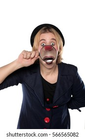 clown holding a magnifying glass in front of his face