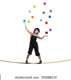 Clown as juggler is balancing on rope