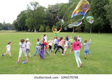 Clown, juggler making giant bubble(s) for the happy children at May 22, 2018 in Budapest, Hungary.