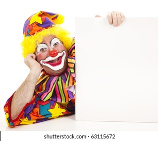 Clown lying on his side holding a blank white sign.
