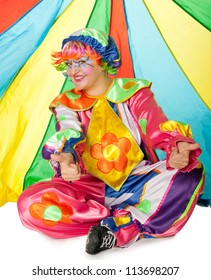 Clown is making fun on colorful background