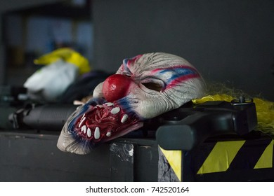 Clown mask and rifle used in bank robbery (backstage of commercial advertising)