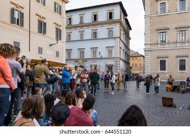 Clown performs at Piazza di Santa Maria in Trastevere, Rome - May 4, 2017