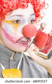 Clown With Problems Sips On A Hip Flask To Help Get Through The Working Day When Drinking On The Job - Isolated On White Background