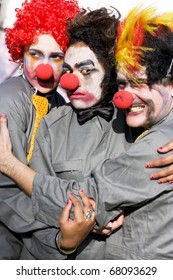A Clown Stuck In The Middle With Clowns To The Left And Jokers To The Right