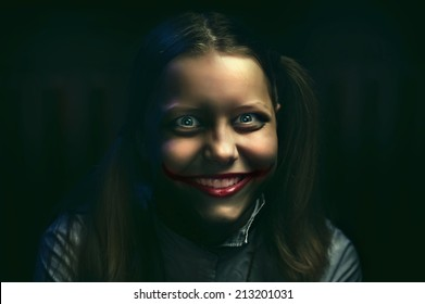 Clown teen girl with a sinister smile