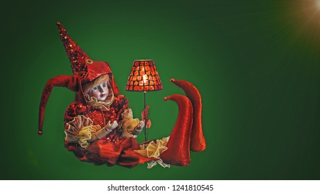 Clown Venetian toy in red dress on green background