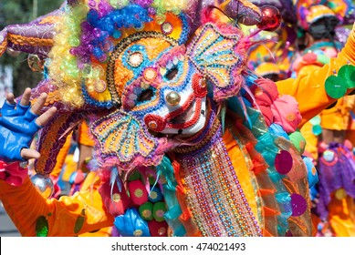 Clown wearing colorful costume for Masskara Festival, Bacolod City, Philippines