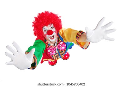 Clown in a white studio stretching his hands to the camera
