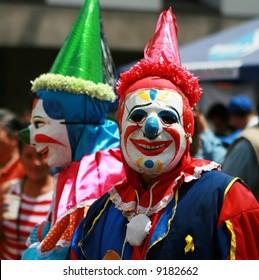 Clowns entertain the crowds at a street festival in Quito, Ecuador
