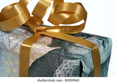 Clse up on gift box made of money bills. The currency is swedish krona. Isolated on white with clipping path.
