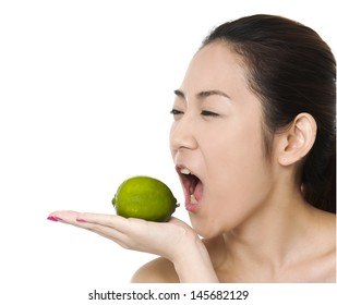 Clseup head shot of woman holding green lime