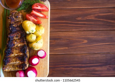 Club Beef steak with pepper sauce and Grilled vegetables on cutting board on dark wooden background