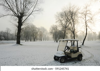 club car on winter golf course