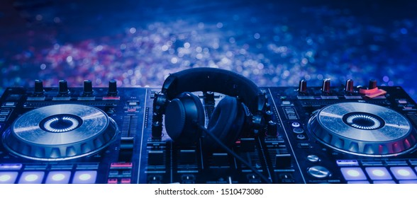 Club Concert Party Musical EDM Sound on Stage Show DJ . Bokeh Blur Background.