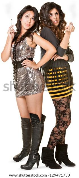Club girls in mini skirts holding cigarettes