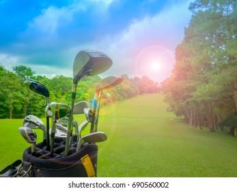 club golf in golf bag on beautiful fairway in golf course on blue sky on lens flair