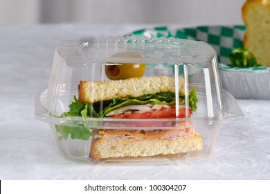 Club House Sandwich in a plastic take out container