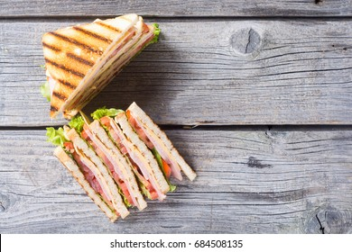 Club sandwich with bacon, tomato, cucumber and herbs . Top view with space for text