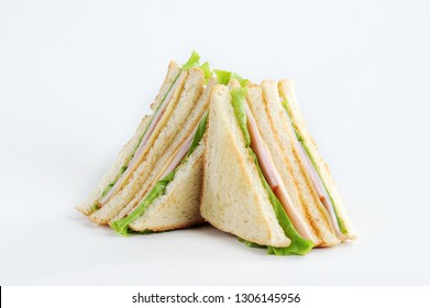 Club sandwich with cheese and party on a white background. White bread is used to make a sandwich. Close-up.