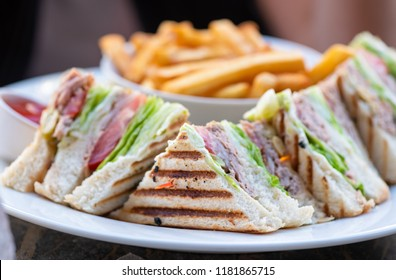 Club Sandwich with chicken and Tuna and french fries