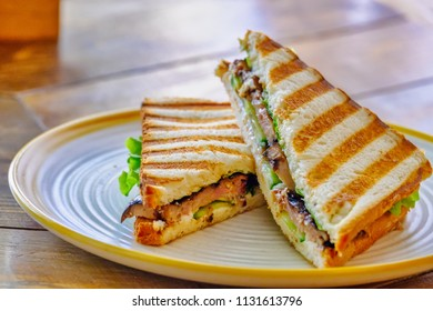 Club Sandwich with Chicken and Vegetables On Plate