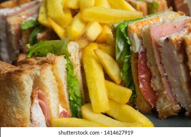 A club sandwich (clubhouse sandwich) is a sandwich of toasted bread, sliced cooked chicken or turkey, ham or fried bacon, lettuce, tomato, and mayonnaise. It is served with french fries.