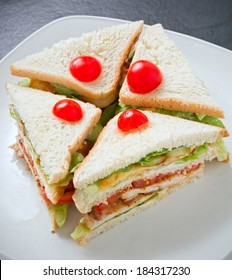 Club sandwich or clubhouse sandwich with toasted bread cut into quarters