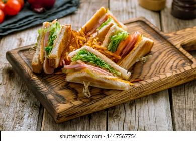 club sandwich with ham on the board