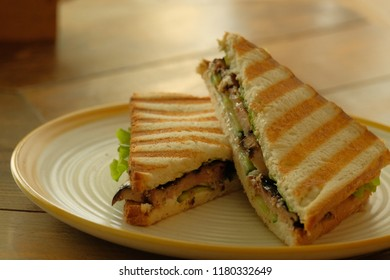 club sandwich on toasted bread on the plate