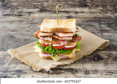 Club sandwich on wooden table background