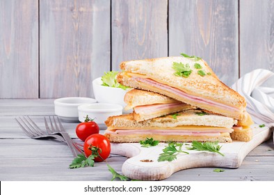 Club sandwich panini with ham, cheese and salad. Tasty breakfast