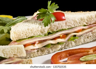 Club sandwich with processed cheese, ham and bell pepper